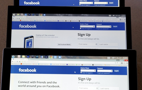 Computer screens display the Facebook sign-in screen in this photo illustration taken in Golden, Colorado July 28, 2015. Facebook, Inc. is to announce its second-quarter earnings July 29, 2015.  REUTERS/Rick Wilking